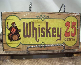 1973 Whiskey 25 Cents Sign,Wallace Berries and Co,Bar Sign,Man Cave Decor,Man on Barrel,Whiskey Barrel