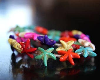 26 synthetic turquoise starfish beads, mixed colors, 14 x 5 mm, hole 1 mm