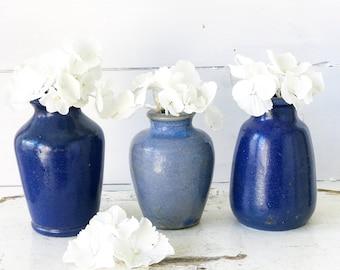 A pretty set of three Victorian blue glazed pots