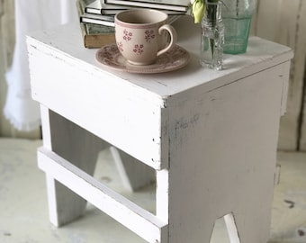 A gorgeous pale vintage pink chippy paint milking stool