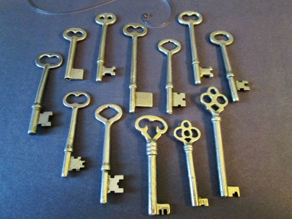 12 Assorted Vintage Shiny Metal Keys for your Home Projects - Steampunk Art - Jewlery Making - Metal Working