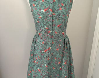Vintage inspired handmade shirtdress. Green with bird print and dipped hem. UK 10
