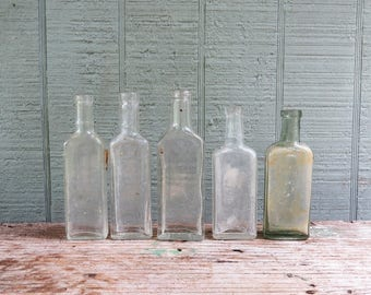 5 Antique Medicine/Apothecary Bottles- 4 Clear & 1 green Dr Tichenors