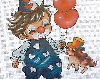 Set of cross stitch counted depicting little boy dressed as a clown and dog