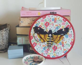 Death's Head Hawks Moth, lovingly embroidered by hand and comes displayed in an embroidery hoop