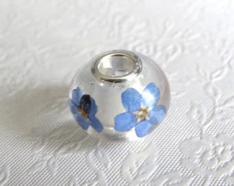Forget me not charm bead. Sterling silver core. 925 stamped bead. Resin bead with pressed forget me not flowers.