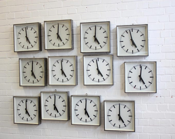 Polished Mid Century Factory Clocks By Pragotron Circa 1960's