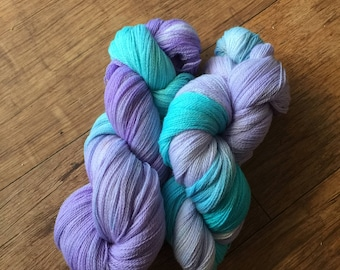 Turquoise and lilac hand dyed  2 ply lace weight merino wool yarn ..
