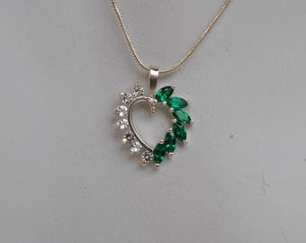 Lab Created Emerald Heart Pendant with Cubic Zirconia Accents.