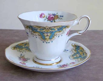 Tuscan Fine English Bone China Vintage Teacup and Saucer in Blue and Gold with Pink Rose Pattern with Gold Gilding