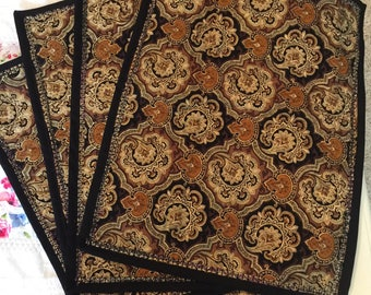 Bronze colored placemats with decorative stitching