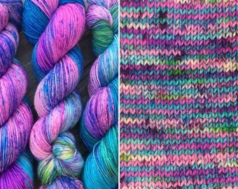 Fizzy Blue Raspberry, speckled merino nylon blend sock yarn with silver stellina