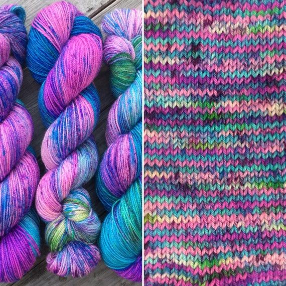 Fizzy Blue Raspberry, speckled merino nylon blend sock yarn with silver stellina