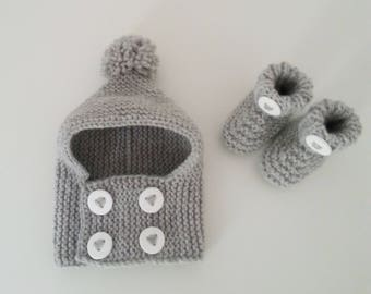 Hat(Cap) cowl and slippers for born babies in 12 woolen hand-knitted months intoxicates(tints) with pompom and buttonhole