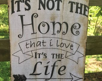 Vintage inspired wood home decor sign. It's not the home that I love, its the life that is lived here