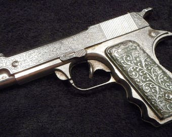 Hubley Forty-five nickle w/green stained grip. As made.