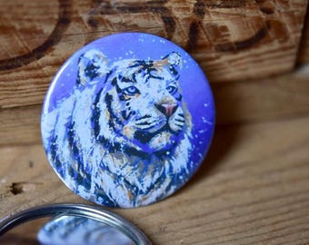Pocket mirror with a white tiger