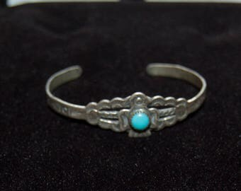 Vintage Native American sterling silver child's bracelet with small blue turquoise.