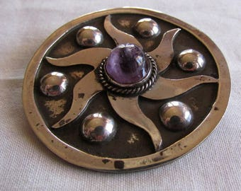 Vintage Sterling Silver and Amethyst Sun Design Pin from Taxco