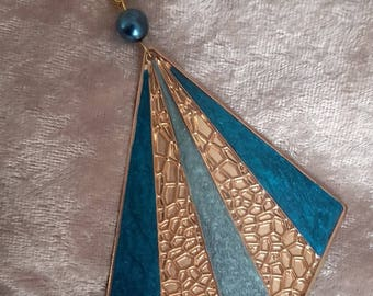 great chic grey gold ultramarine blue resin and metal pendant