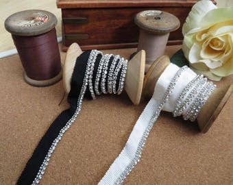 1m of off white or Black grosgrain ribbon with diamante edging. This is a hem trimming, 14mm width.
