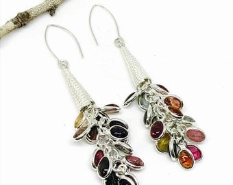 10% Tourmaline earrings. Set in sterling silver 92.5. Natural authentic multicolor stone earring. Length- 2.25 inch long.