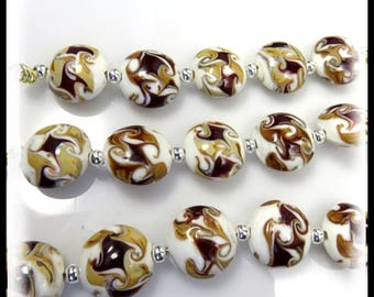 White lampwork glass lentils with swirls of burgundy and golden yellow.  Sets of 5. Size 16mm Lampwork lentil beads