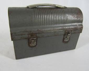 Vintage rusty domed metal lunchbox