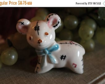 SALE Small Ceramic Teddy Bear Figurine with Hand Painted Stitching and Blue Bow