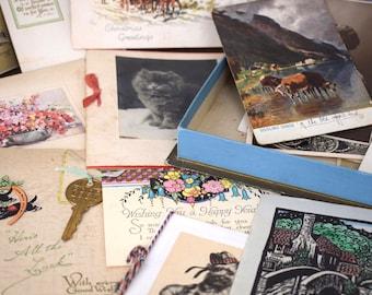 Vintage ephemera, photographs and greeting cards, in original cardboard chocolate box