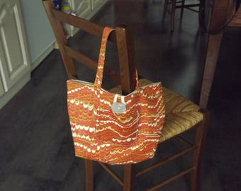 Handbag in orange/gray reversible fabric, with pockets and button