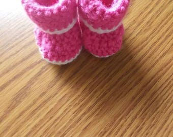 Crochet baby booties with white bottoms and trim. Newborn-9month sizes available.