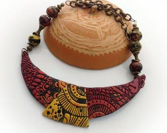 Necklace; bib; African style; Yellow; Orange; Bordeaux; black.