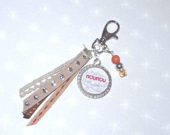 Beige Christmas nanny who torn tones gift bag/key charm