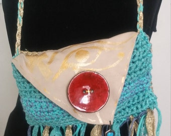 crocheted and leather fringed purse