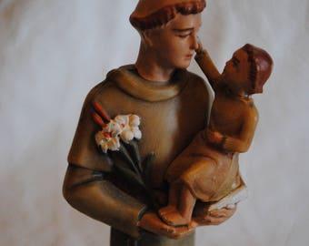 Religious figure holding child