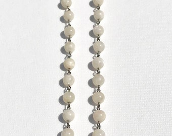 Moonstone necklace with detachable moonstone pendant.