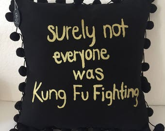 surely not everyone was kung fu fighting pom pom pillow black/gold