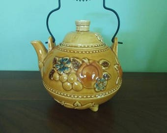 Vintage gold ceramic teapot