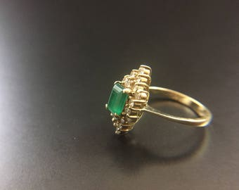 14K yellow gold ring with emerald and diamonds, size 5, weight 3.5 grams