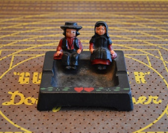 Amish Man and Woman Cast Iron Ashtray