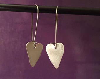 Sweet Hearts dangling from a sterling silver wire