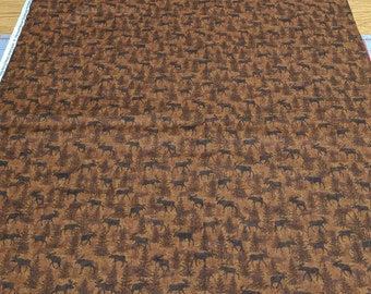 Moose on the Loose Dark Brown Cotton Fabric from Benartex