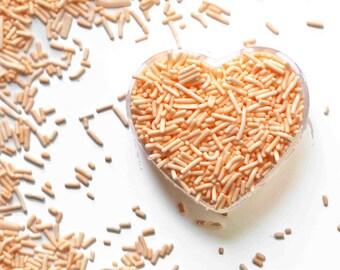 Peach Crunchy Jimmies™, crunchy sprinkles, skinny sprinkles, sugar strands, peach sprinkles, peach jimmies, Fancy Sprinkles