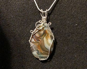 Onyx Agate pendant with Silver-plated wire and 925 Sterling Silver Silver-filled chain.  A 10