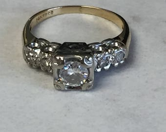 14kt Yellow and White Gold Lady's .73ctw  Diamond Engagement Ring with a Vintage Style.