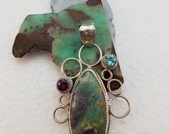Handcrafted, textured, sterling silver pendant, ruby zoisite cabochon, faceted raspberry rhodolite garnet and blue topaz gems