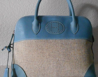 Hermes rare Bolide 31 canvas hand bag Clemence leather pebbled trim with light blue leather interior leather with lock and key