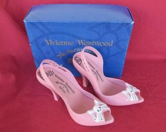 paire de chaussure vintage Vivienne Westwood tête de mort T.39,PVC recyclé, très confortable,pointure 39 Europe,8 USA,37 Brésil