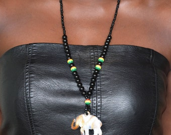 Necklace with elephant pendant.